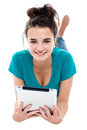 Glamorous pretty girl posing with wireless tablet Royalty Free Stock Image