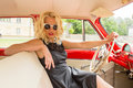 Glamorous woman driving a vintage car Royalty Free Stock Photo