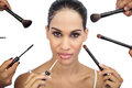 Glamorous woman encircled by make up brushes on white background Royalty Free Stock Image