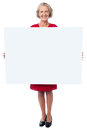 Glamorous woman holding blank ad board attractive aged lady presenting whiteboard Stock Photos