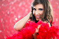 Glamorous woman with red feathers Royalty Free Stock Photography