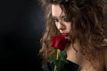 Glamorous young woman with rose Stock Photography