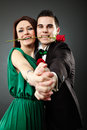 Glamour close up of charming young couple dancing tango over gra beautiful and holding a rose in their teeth valentine concept Stock Photo