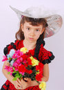 Glamour girl with flowers a little dressed in an elegant outfit holding Stock Image