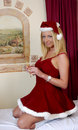 Glamour girl in santa outfit and hat Royalty Free Stock Image