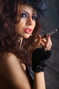 Glamour girl smoking studio portrait holding pipe Stock Photography
