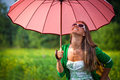 Glamour happy woman under umbrella young with the summer rain beautiful girl enjoying rainy summer day looking up at sky smiling Stock Photos