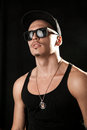 Glamour male model in sunglasses on black background studio Stock Photos