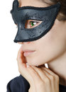 Glamour mask closeup photo of a young lady with green eyes wearing a black Royalty Free Stock Images