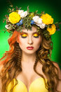 Glamour model with wreath on green background in studio Stock Images