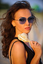 Glamour outdoor portrait of beautiful brunette female model Royalty Free Stock Photo