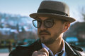 Glamour portrait of beauty man in hat and glasses looking away o outdoors at daytime Stock Image