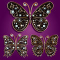 Glamour set collections of vintage golden butterfl butterflies with elegance ornament encrusted with blue jewels on purple Stock Photo
