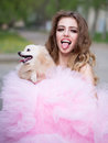 Glamour woman with dog Royalty Free Stock Photo