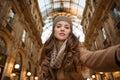 Glamour woman taking selfie in Galleria Vittorio Emanuele II Royalty Free Stock Photo