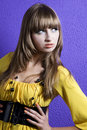Glamour women over blue wall Stock Images