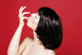 Glamourous closeup model portrait fashion female eyeliner makeup on eyes cosmetics and make up Stock Photo
