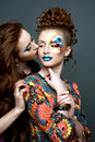 Glamourous ladies two sensual young women with artistic make up Royalty Free Stock Image