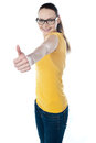 Glamourous teenager gesturing thumbs-up Stock Photography