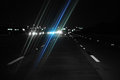Glare night driving from oncoming traffic s headlights Royalty Free Stock Photos