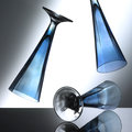 Glas blue cocktail glasses on their way to the ground with grey backround Stock Images