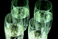 Glas of champagne in closeup glasses with black background Royalty Free Stock Photography
