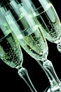 Glas of champagne in closeup glasses with black background Royalty Free Stock Photo
