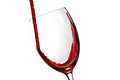 Glas with red wine splash on white background Stock Photo