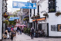 Glasgow uk – june view of ashton lane a cobbled backstreet in the west end full pubs and restaurants Royalty Free Stock Photography
