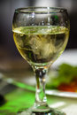 Glass of alcohol white wine or vermouth and ice picture proper for menu design Stock Images