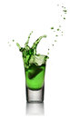 Glass of alcoholic drink with ice. Absinthe or mint liquor shot Royalty Free Stock Photo