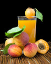 Glass apricot juice and fruits black isolated fruit studio shot Stock Photos