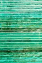 Glass background with stripe pattern in hue of green color