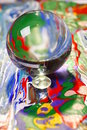 Glass ball on colorful surface Royalty Free Stock Image