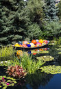 Glass Balls and Lilly Pads in Pond Royalty Free Stock Photo