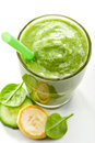 Glass of banana, cucumber and spinach smoothie Royalty Free Stock Photo