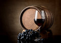 Glass and barrel of red wine a wooden Stock Photo