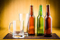 Glass of beer with bottles drink bubbles Stock Photo