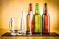 Glass of beer with bottles drink bubbles Stock Image