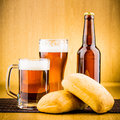 Glass of beer with bottles drink bubbles Stock Photography