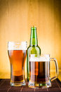 Glass of beer with bottles drink bubbles Royalty Free Stock Photography