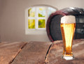 Glass of beer and a cask Royalty Free Stock Photo