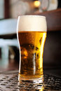 Glass of beer close-up with froth Stock Image