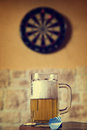 Glass of beer and dartboard, filtered Royalty Free Stock Photo