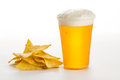 Glass of beer and mexican tortilla chips on white background Royalty Free Stock Photography