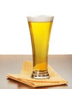 Glass of beer on napkin and a gray background Royalty Free Stock Image