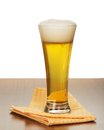 Glass of beer and napkin on a gray background Stock Images