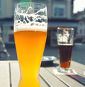 Glass of beer on an outdoor patio Stock Images