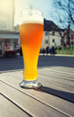 Glass of beer on an outdoor patio Royalty Free Stock Images