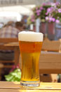 Glass of beer in restaurant on the table outdoor sun Stock Photo